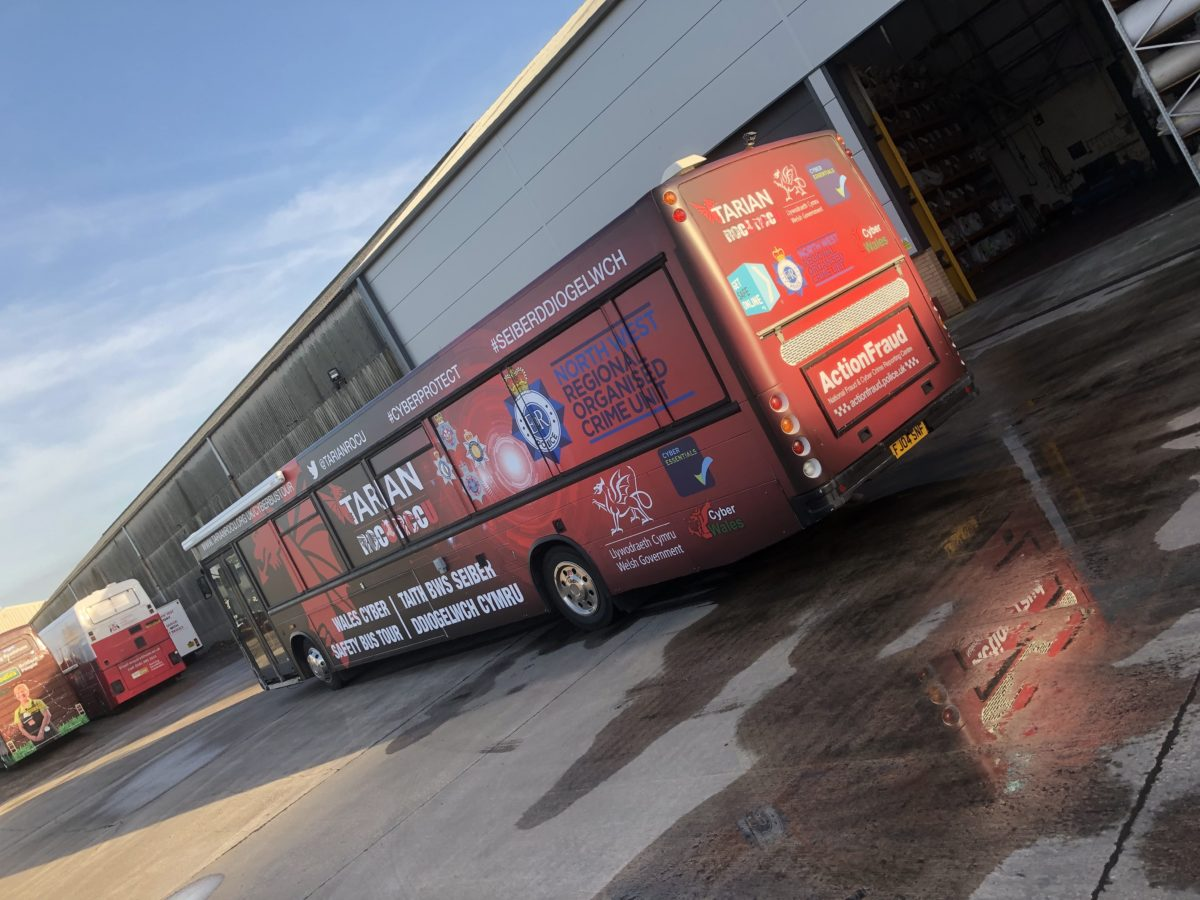 cyber crime bus wraps vehicle graphics