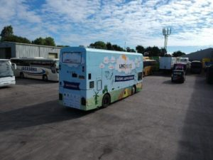 rear and side vehicle graphics bus wrap