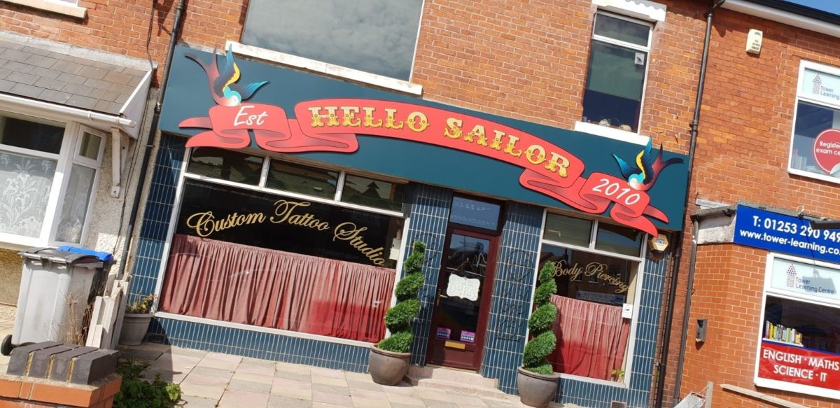 hello sailor tattoo studio signage